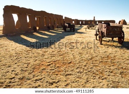 Fort Union ruins and old west wagons - stock photo