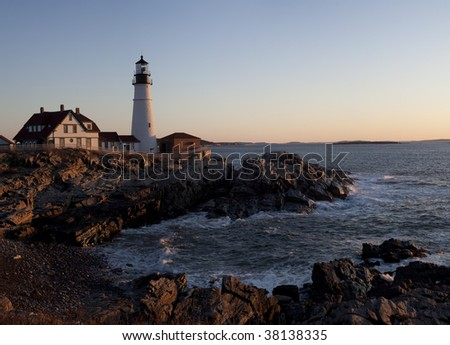 Fort Williams lighthouse in South Portland Maine in late March at sunrise