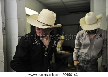 Fort Worth, Texas, USA, March. 24, 2012: Cowboys before Rodeo at Fort Worth Stockyards Historic District, former livestock market, now main tourist attraction in Fort Worth, TX - stock photo
