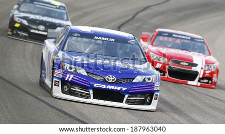 Fort Worth, TX - Apr 04, 2014:  Denny Hamlin (11) takes to the track for a practice session for the Duck Commander 500 at Texas Motor Speedway in Fort Worth, TX. - stock photo
