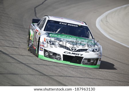 Fort Worth, TX - Apr 04, 2014:  Kyle Busch (18) brings his race car through the turns during a practice session for the Duck Commander 500 at Texas Motor Speedway in Fort Worth, TX. - stock photo