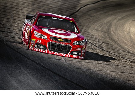 Fort Worth, TX - Apr 04, 2014:  Kyle Larson (42) brings his race car through the turns during a practice session for the Duck Commander 500 at Texas Motor Speedway in Fort Worth, TX. - stock photo