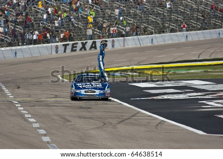 FORT WORTH, TX - NOV 06:  Carl Edwards holds off Kyle Busch and the rest of the field to win the O'Reilly Auto Parts Challenge race on NOV 6, 2010 at the Texas Motor Speedway in Fort Worth, TX. - stock photo