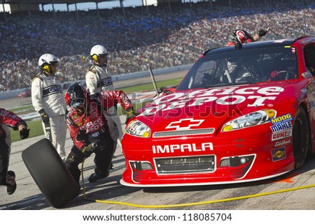FORT WORTH, TX - NOV 04:  Tony Stewart (14) brings in his car for a pit stop during the AAA Texas 500 at Texas Motor Speedway in Fort Worth, TX on Nov 4, 2012. - stock photo