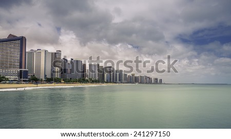 Fortaleza Beach with tall buildings in Ceara state, Brazil - vintage look - stock photo