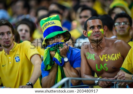 FORTALEZA, BRAZIL - July 4, 2014: Brazil fans at the FIFA 2014 World Cup quarter-finals game between Brazil and Colombia at Estadio Castelao. NO USE IN BRAZIL.