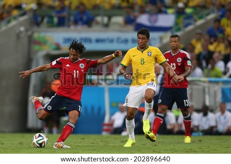 FORTALEZA, BRAZIL - JULY 04, 2014: Cuadrado of Colombia and Paulinho of Brazil during the World Cup Quarter-finals game between Brazil and Colombia in the Estadio Castelao. NO USE IN BRAZIL.