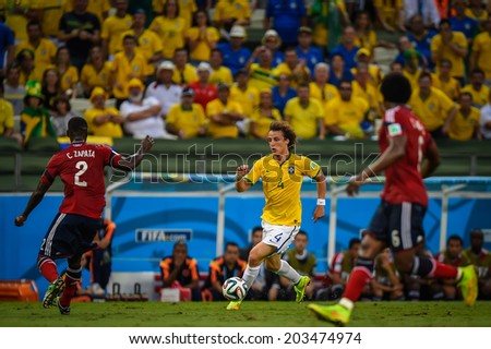 FORTALEZA, BRAZIL - July 4, 2014: David Luiz of Brazil competes for the ball during the FIFA 2014 World Cup quarter-finals game between Brazil and Colombia at Estadio Castelao. NO USE IN BRAZIL.
