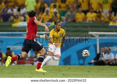 FORTALEZA, BRAZIL - JULY 04, 2014: Neymar of Brazil compete for the ball during the World Cup Quarter-finals game between Brazil and Colombia in the Estadio Castelao. NO USE IN BRAZIL.