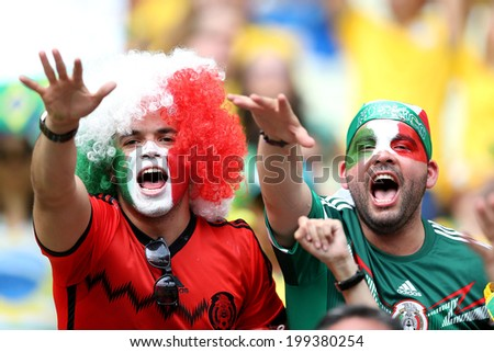 FORTALEZA, BRAZIL - June 17, 2014: Mexican fans celebrating during the World Cup Group A game between Brazil and Mexico at Estadio Castelao. No Use in Brazil.