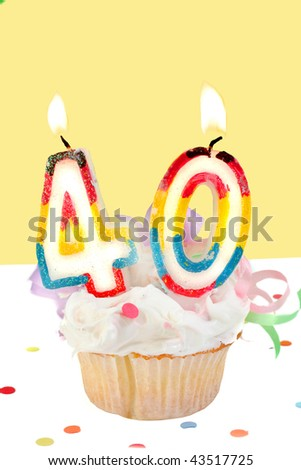 fortieth birthday cupcake with white frosting and yellow decorative background - stock photo