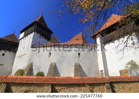 Fortified church from UNESCO world heritage list in Viscri village, Transylvania, Romania - stock photo