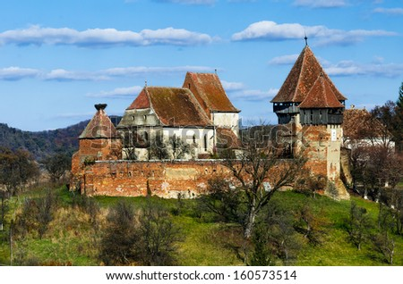 Fortified Church in Transylvania, Romania. Medieval scenery with fortified churches. Alma Vii rural church was built in 16th century by saxons in gothic architecture style.