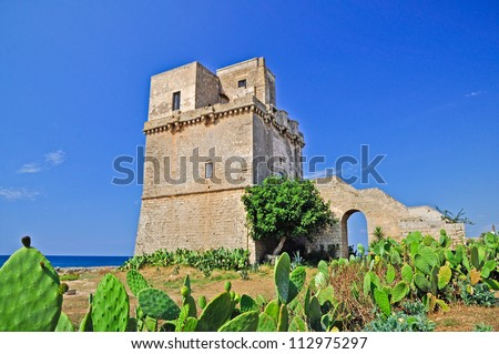 Fortified tower in Punta Colimena. Apulia. Italy.