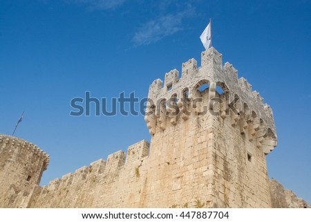Fortified walls and bastion of medieval fortress protecting the harbor Trogir, Croatia - stock photo