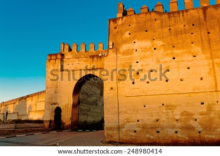 Fortified walls surrounding ancient city of Fes in Morocco - stock photo