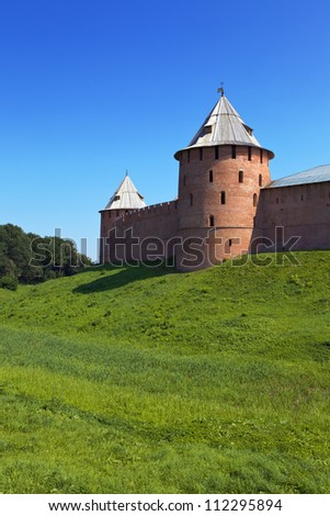 Fortress wall with watch-towers of red brick