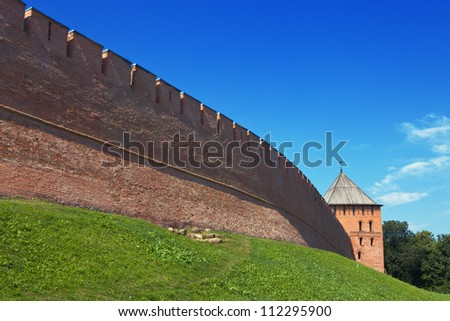 Fortress wall with watch-towers of red brick - stock photo