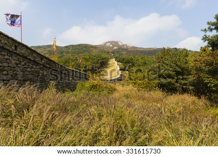 fortress walls leading up Geumjeong mountain