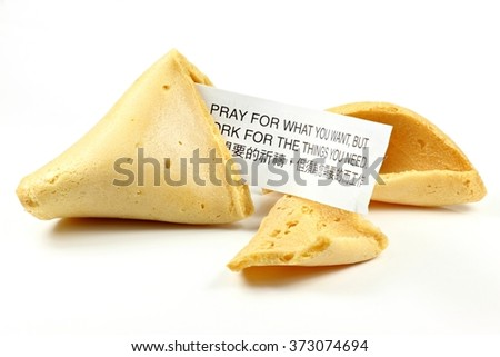 fortune cookie isolated on white background (bilingual text - translation is shown in the image) - stock photo