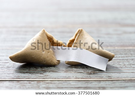 Fortune cookie with blank slip isolated on table. - stock photo