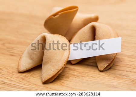 fortune cookie with note - stock photo