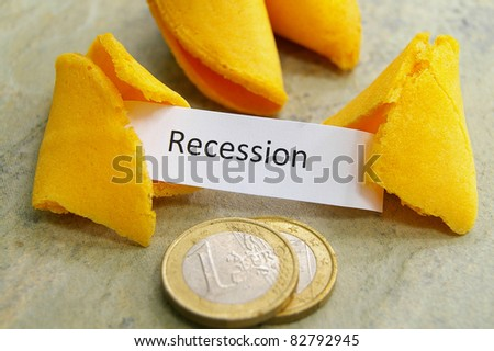 fortune cookie with recession message and Euro coins