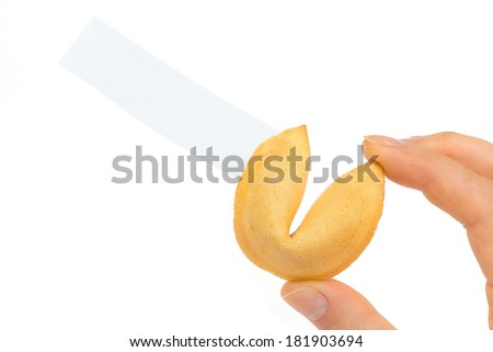Fortune cookies in hand with blank slip isolated on white background  - stock photo