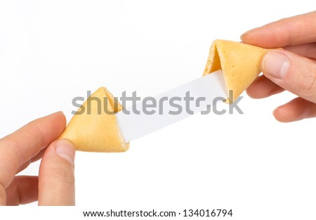 Fortune cookies in hands with blank slip isolated on white background - stock photo