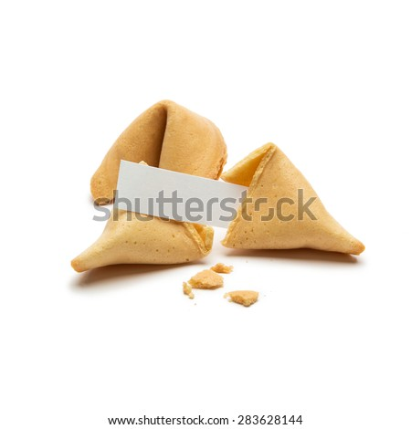 fortune cookies with crumbs and note  - stock photo