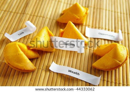 fortune cookies with opportunity, wealth, success messages - stock photo
