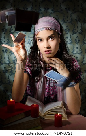 Fortune teller is throwing the cards