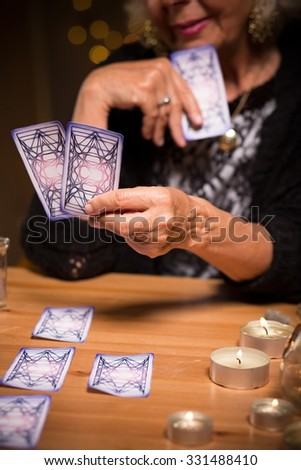 Fortune teller reading future from tarot cards - stock photo