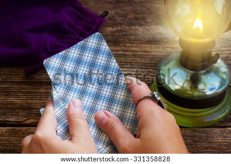 Fortunetelling with  Tarot deck - hands holding cards - stock photo