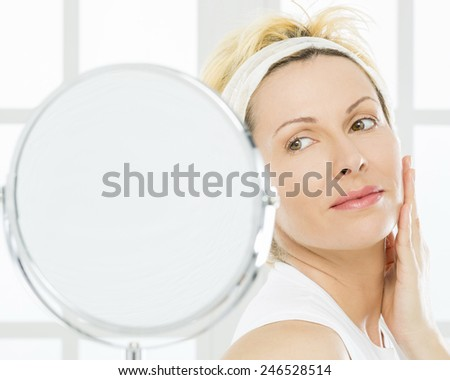 Forty years lady and mirror temptation - stock photo