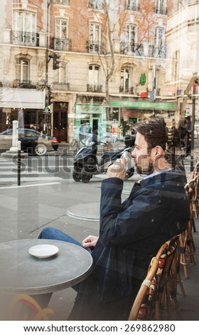 Forty years old caucasian man in casual outfit drinking coffee in Paris cafe. City lifestyle - relax. - stock photo