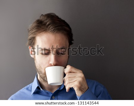 Forty years old sleepy office worker man drinking morning coffee - stock photo