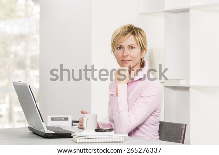 Forty years woman at work with positive attitude