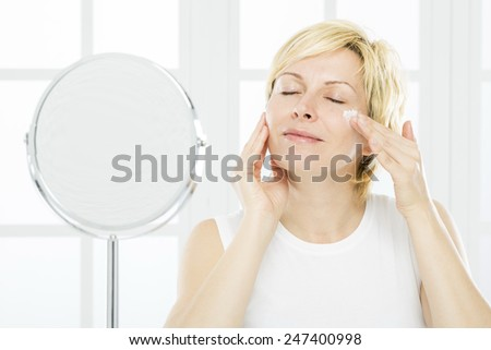Forty years woman, nursing and mirror - stock photo