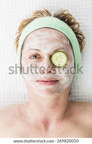 Forty years woman on cosmetics treatment - stock photo