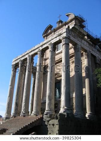 Forum Romanum -- Temple of Antoninus and Faustina (Rome) - stock photo