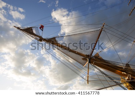 forward mast of the sailing ship against the sky - stock photo
