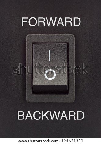 forward or backward black toggle switch on black surface positive negative - stock photo