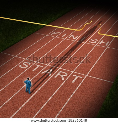 Forward thinking business concept for success acceleration as a businessman standing on the start line in a track and fieild path with a cast shadow breaking through the victory finish line ribbon.