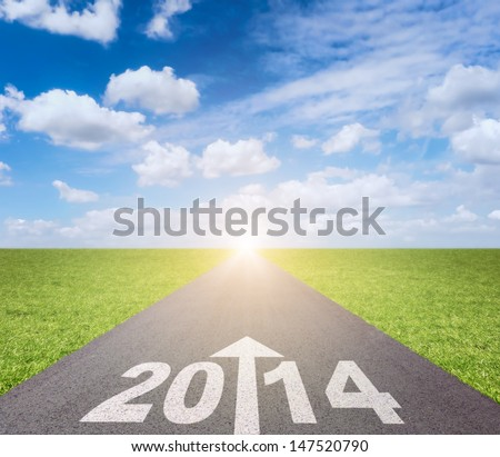 Forward to 2014 concept with date and arrow on road - stock photo