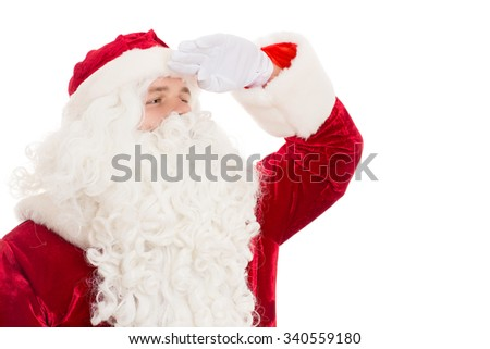 Forward to new beginnings. Santa Claus looking away for direction holding his hand to his forehead - stock photo