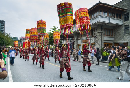 FOSHAN April 21:Once a year the parade held in Foshan, Taoist wearing traditional costumes to guard the Taoist God tour activities, attracted many people to watch April 21, 2015 in Foshan, China - stock photo