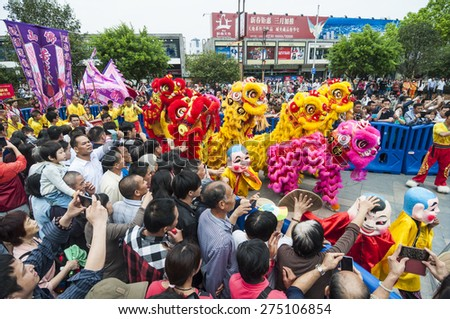 FOSHAN-April 21:The annual parade of Taoism in the heart of the city road, lion took part in the parade, good show attracted many citizens to watch and take photos April 21, 2015 in Foshan, China - stock photo