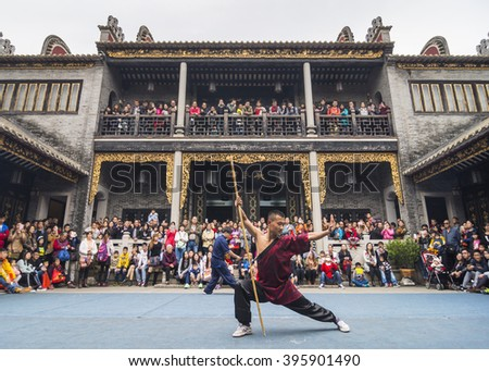 FOSHAN,CHINA-February 14,2016:Kung fu team in front of the museum show, attracted many people to watch. Foshan city is the birthplace of Chinese kung fu, citizens enjoy practicing kung fu to exercise. - stock photo