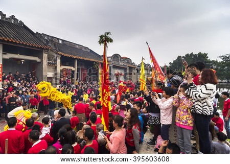 FOSHAN, CHINA - February 11, 2016: SongTang village traditional ethnic Chinese New Year parade held in front of the ancient ancestral temple, activities held once every three years, very lively. - stock photo